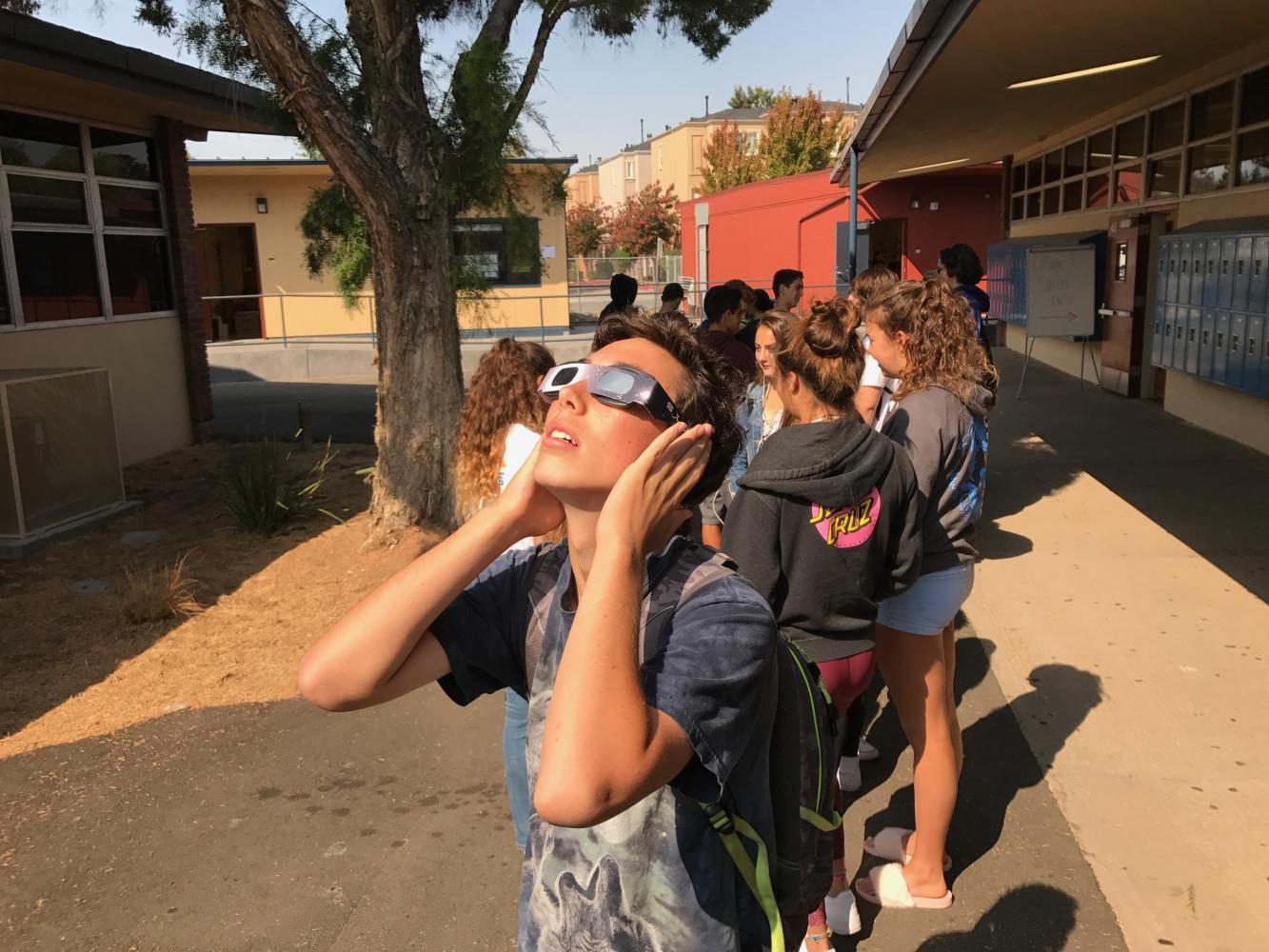 Sophomore Alex Morgan views Monday's solar eclipse during tutorial.