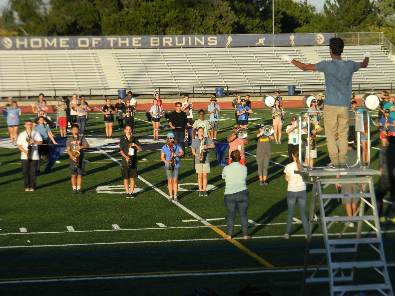 drum major and senior Savidu Geevaratne leads the royal alliance through rehersal