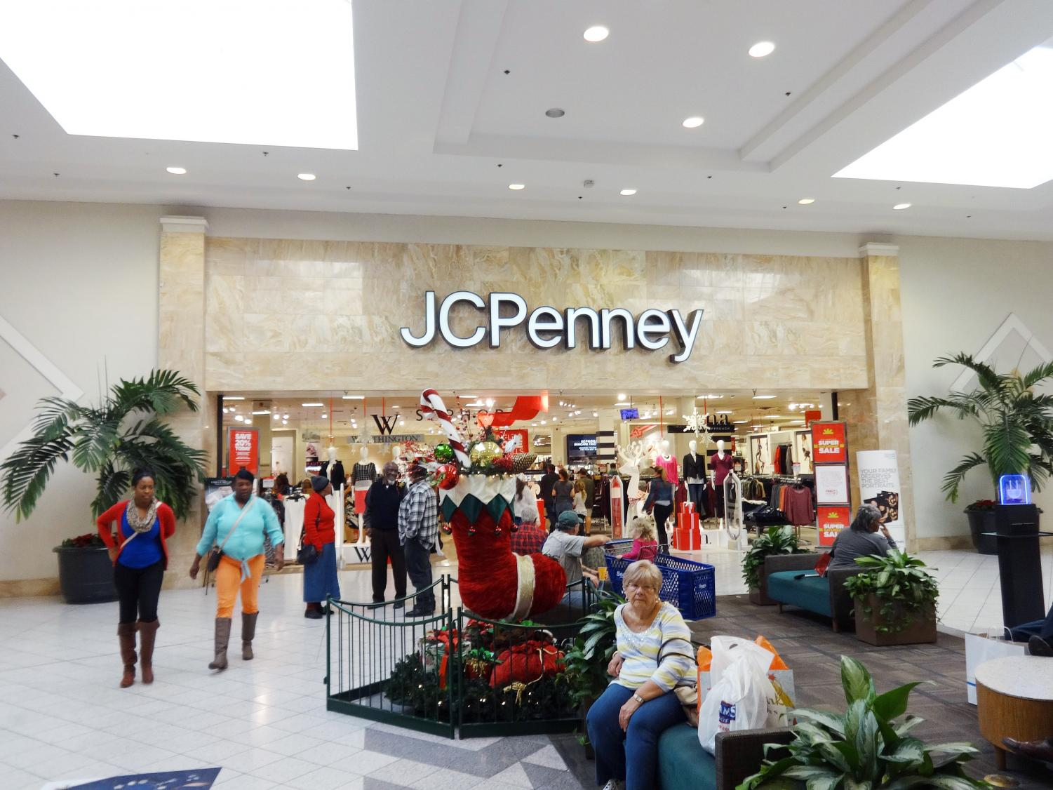 Shoppers wait outside of the JC Penney at Oakridge Mall. This shopping season, teens are more likely to shop online.