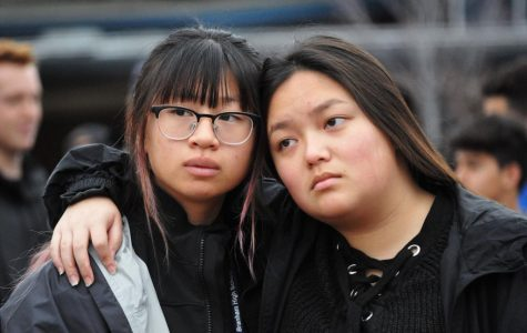 Regine Quintos/Bear Witness file Aivy Dang and Isabelle Trinch embrace outside in the quad, urging for gun reform in the U.S. Last year students participated in a walk out as part of the March for Our Lives campaign.