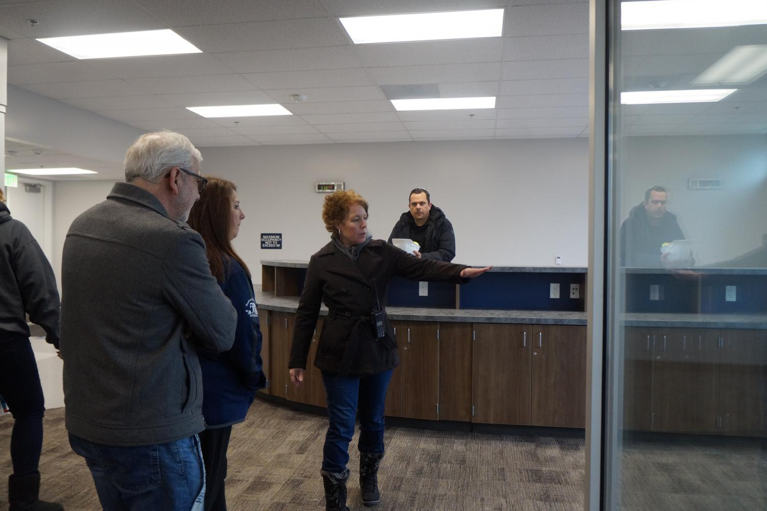 Principal Cheryl Lawton takes teachers on a tour of a finished campus building.