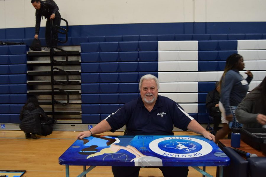 Announcer Bob Holmes said he had wanted to spruce up his standard folding table, and reached out to Branham's Art Club.
