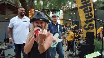 English teacher Tobie Schweizer shows off a Steelers ring at a performance